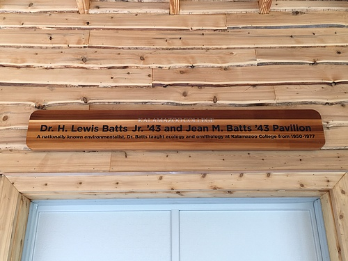 "Sign in the Pavilion that reads ""Dr. H Lewis Batts Jr '43 and Jean M. Batts '43 Pavilion. A nationally known environmentalist, Dr. Batts taught ecology and Ornithology at Kalamazoo College from 1950-1977"