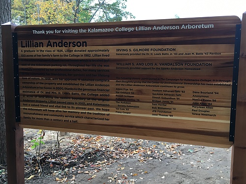 Back side of the welcome sign in the parking lot that lists donors and a short history of Lillian Anderson